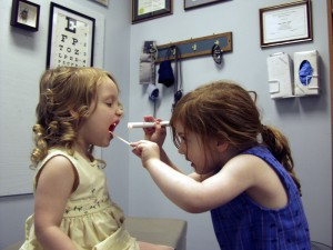 little girl's playing doctor